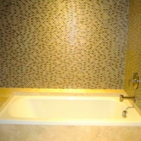 Oval glass tile, travertine
